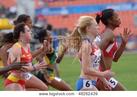 DONETSK, UKRAINE - JULY 11: Sivkova, Russia (center), Washington, USA (right) and other girls compete in 100 m during 8th IAAF World Youth Championships in Donetsk, Ukraine on July 11, 2013.