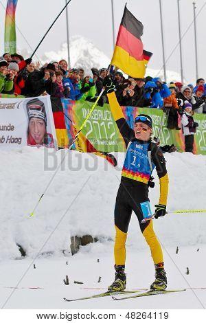SEEFELD, AUSTRIA - JANUARY 19 Niklas Homberg of team Germany wins the mixed biathlon relay event on January 19, 2012 in Seefeld, Austria.