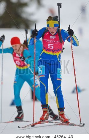 SEEFELD, AUSTRIA - JANUARY 19 Linn Persson of team Sweden places 6th in the mixed biathlon relay event on January 19, 2012 in Seefeld, Austria.