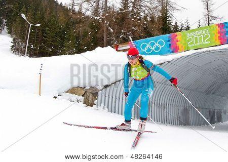 SEEFELD, AUSTRIA - JANUARY 19 Anastasiya Merkushyna of team Ukraine places 4th in the mixed biathlon relay event on January 19, 2012 in Seefeld, Austria.