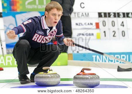 INNSBRUCK, AUSTRIA - JANUARY 20 Mikhail Vaskov (RUS) and his partner from the Czech Republic beat team Estonia and Italy in the curling mixed doubles by 10:3 on January 20, 2012 in Innsbruck, Austria.