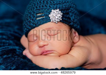 Newborn Baby Girl in a Teal Flapper Hat