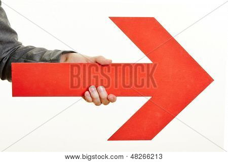 Hand holding a red arrow pointing to the right