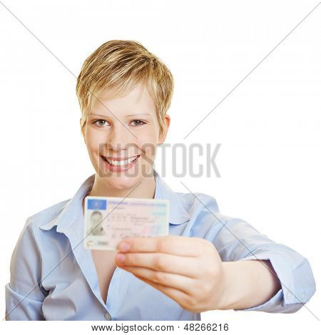 Proud young woman showing off her new drivers licence