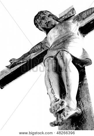 Low Angle View Looking Up At A Statue Of Jesus On A Cross