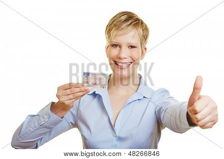 Happy young woman with German drivers licence holding thumbs up (signature is faked)