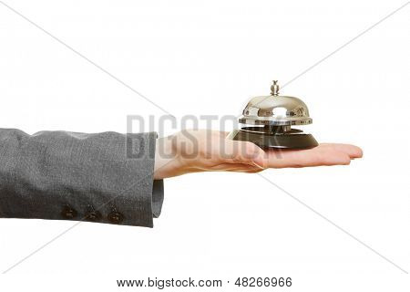 Hand holding hotel bell on the palm