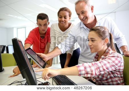 Teacher with students in computing class