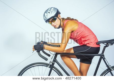 Young Female Professional Cycling Athlete Posing With Racing Bike.model Equipped With Professional S