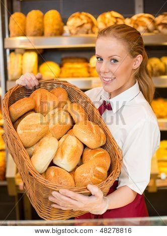 Baker In Bakery With Basket Full Of Bread