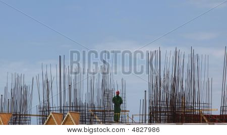 Construction Worker With Steel Rebar