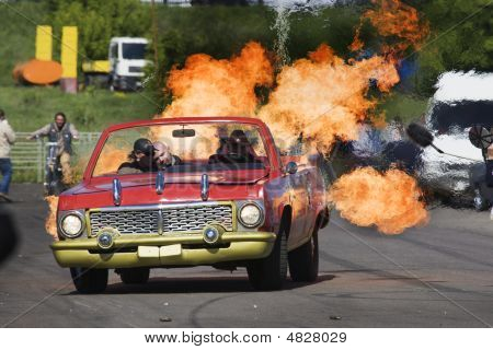 Moscow,russia - 06 June, 2008:stantman Vasiliy Stratov Driving On A Car With Flames At Stantmans Sho