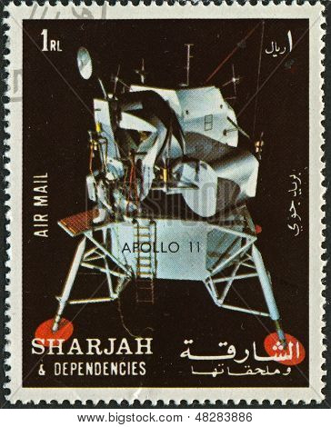 SHARJAH - CIRCA 1972:A stamp printed in Sharjah shows image of the Apollo 11 was the spaceflight that landed the first humans on the Moon, Neil Armstrong and Buzz Aldrin, on July 20, 1969, circa 1972.