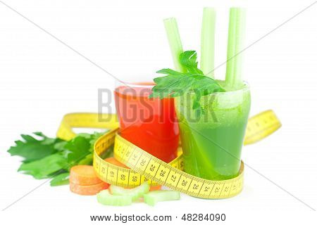 Measuring Tape, Glass Of Celery Juice And Glass Of Carrot Juice Isolated On White