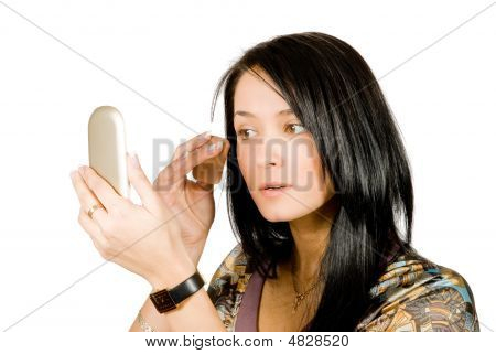 Pretty Young Woman Applying Make-up