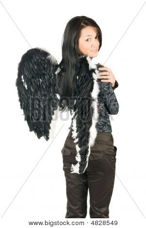 Beautiful Young Woman With Black Wings. Isolated Over White Background