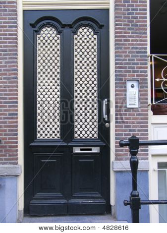 Ornamental Wooden Black Door With Intercom