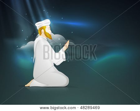 Young Muslim man praying (Namaz, Islamic prayer) in the blue sky background.