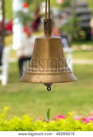 Bronze Bell In A Garden