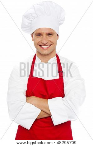 Portrait Of A Smiling Chef With Arms Crossed