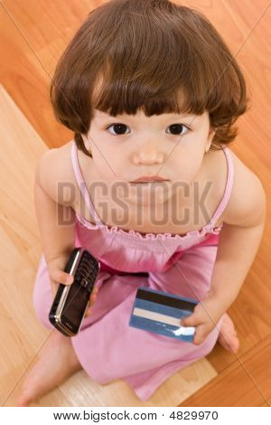 Little Girl With Phone And Baking Card