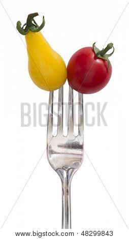 yellow and red tomatoes on the fork, diet concept