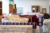 image of thrift store  - New colorfull sofas in a furniture shop - JPG