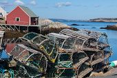 stock photo of lobster trap  - Lobster traps piled up on a wharf in Peggy - JPG