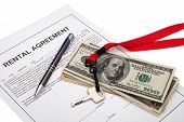 stock photo of rental agreement  - House key and cash with rental agreement