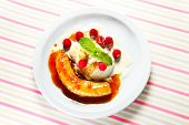 picture of banana split  - A picture of banana split dessert served on a white plate - JPG