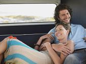 image of campervan  - Loving young couple relaxing in campervan during road trip - JPG