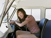 stock photo of campervan  - Portrait of beautiful young woman smiling in driver - JPG