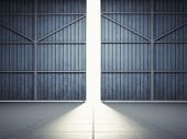 image of door  - Bright light in open hangar doors - JPG