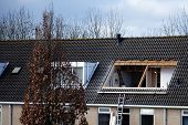 picture of gabled dormer window  - Building a large dormer on a roof  - JPG