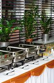 stock photo of chafing  - chafing dish heaters at the banquet table - JPG