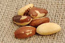picture of brazil nut  - Closeup of some Brazil nuts on burlap - JPG