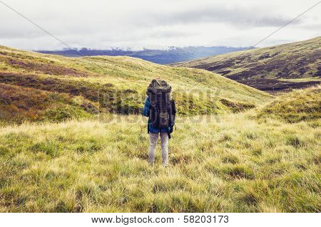 Backpacker Standing In The Middle Of The Wilderness