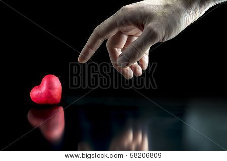 Man Pointing To A Red Heart
