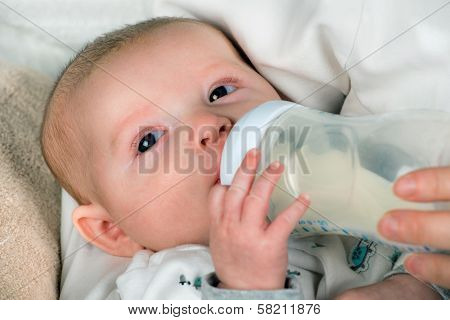 Infant baby feeding from bottle