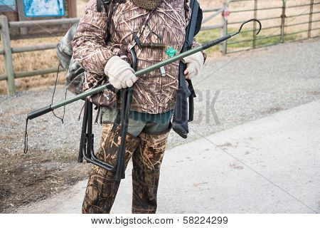 Duck Hunter In Camouflage With Shotgun
