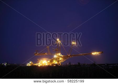 Giant Excavator In A Coal Open Pit Evening