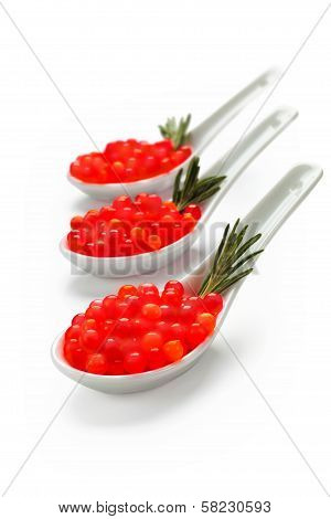 Red Caviar On Porcelain Spoons Uncluttered