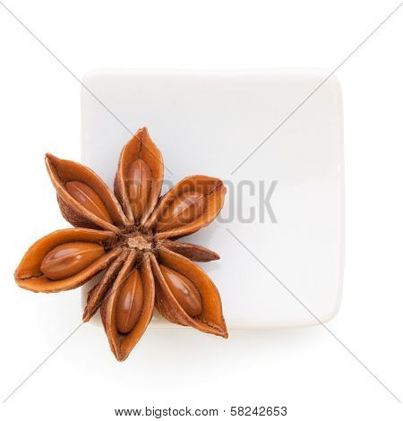 Anise Star (illicium Verum)  In A White Bowl On White Background.