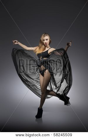 Dynamic Woman With Creative Dress