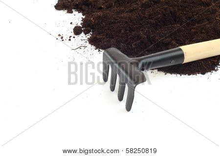 Rake And Dirt Isolated On White