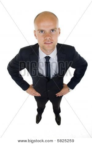 Businessman In Suit Stands With Confidence