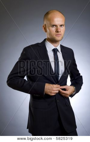 Businessman Buttoning His Coat