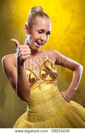 Smiling Ballerina In Yellow Tutu With Thumbs Up