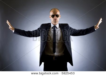 Successful Businessman With Arms Open