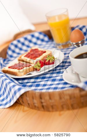 Homemade Breakfast On Wicker Tray With Checked Teacloth